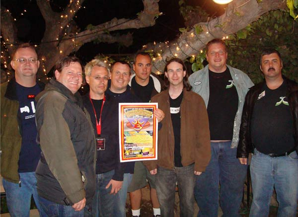 Gary, Paul, and The SC3 Council of Six.  Steve is holding one of the Twin Galaxies posters, signed by Walter Day and Billy Mitchell