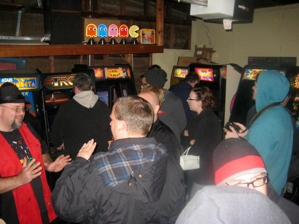 More crowds huddled up in the garage arcade