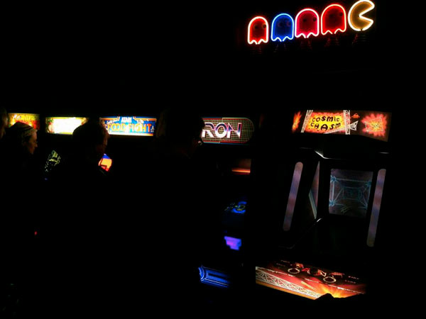 The garage arcade, seen as it actually was (with no camera flash).  Recreates that '80s arcade ambience we all know and love
