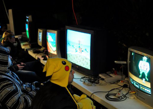 To bundle up at a video game party, why not rock a Pikachu hoodie while you rock some NES Rockin' Kats?
