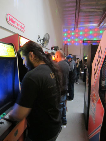 A row of players at 2084 arcade
